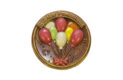 Chokladmedalj med färgrika luftballons aktuell sötsak Royaltyfri Foto