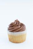 Chokladmuffin och Swirly glasyr på kaka royaltyfri bild