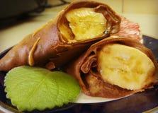 Chokladpannkakor med bananen Fotografering för Bildbyråer