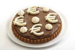 Chokladsockerkaka med eurotecken Royaltyfri Foto