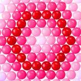 Chokladvalentin godis som täckas i rosa färger, rött och vitt Royaltyfria Foton