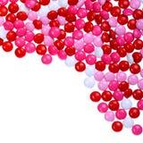 Chokladvalentin godis som täckas i rosa färger, rött och vitt Arkivbild