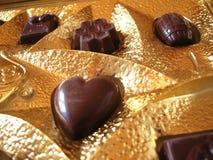 Chokolate in pacchetto dorato Immagine Stock Libera da Diritti