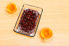 Chokolate pie with cherry on the kitchens table Royalty Free Stock Photography