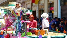 Chola cuencana with giant sombrero or Paja Toquilla hat on the float stock photos