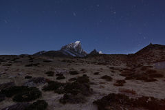 Cholatse Morning Air. An early morning with star trails of Cholatse towering into the air at over 23000 feet.  Everest Region, Nepal Royalty Free Stock Images