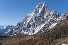 Cholatse mountain peak in the morning Stock Photos