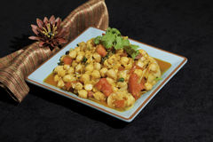 Cholay Curried Chickpeas. On plate with napkin Royalty Free Stock Images