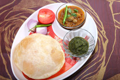 Chole bhature with green chutney and chili topping stock photography