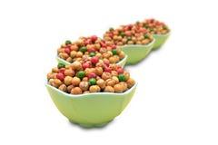 Chole e amendoim fritados na bacia Fotografia de Stock