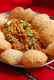 Chole with puri. Traditional mix of Indian cuisine - curried chickpeas and puffed puri Stock Photos