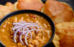 Chole Puri. Indian breakfast meal consisting of Chole  and Puris as the main dish Stock Image