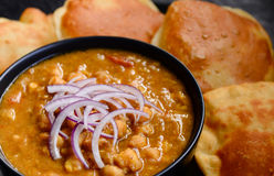 Chole Puri. Indian meal -Chickpeas curry with fried flat bread puri as main course stock photography