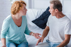 Choleric aged husband and wife quarreling Stock Images