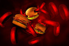Cholesterol blocked artery, medical concept. With a human blood vessel clogged by unhealthy eating fat food as hamburgers, pizza, ice cream and fried foods Royalty Free Stock Image