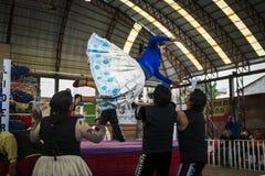 Cholita wrestler during a wrestling fight in the city of El Alto, Bolivia. El Alto, Bolivia - December 8, 2013: Cholita wrestler during a wrestling fight in the Stock Photos