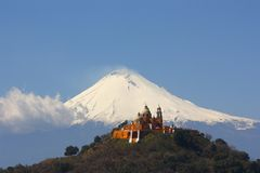 Cholua II. Church of nuestra señora de los remedios with the active volcano popocatepetl behind, located in cholula, puebla Royalty Free Stock Images