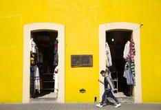 Cholula, Mexico-November 7, 2016-A student walks past a souvenir shop Stock Photo