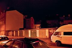 Chomutov, Czech republic - January 05, 2017: garages in nighty Roosevelt street with cars during rain Royalty Free Stock Photo