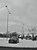 Chomutov, Czech republic - January 20, 2017: snowy parking lot in Mostecka street with black car Opel Astra H Royalty Free Stock Photography