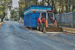 2016/09/24 - Chomutov, Czech republic - little red excavator parked on the street Politickych veznu in Chomutov city during a repa Royalty Free Stock Image