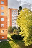 Chomutov, Czech republic - September 20, 2017: sonne is shining between trees and high-rise houses in Bezrucova street  at beginni. Ng autumn Stock Photos