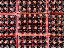 Many coke or coca-cola bottle in a plastic crates for delivered to customers. Chon Buri, Thailand - FEBRUARY 06, 2018 : Many coke or coca-cola bottle in a royalty free stock images