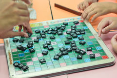 Student playing scrabble cross word royalty free stock image