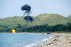 Seal team from international navy ignite bombs on the beach during Cobra Gold 2018 Multinational Military Exercise Royalty Free Stock Images
