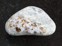 Chondrodite in polished calcite stone on dark Stock Photography