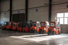 Chongqing Branch of Minsheng Logistics Baotou auto parts warehouse forklifts are operating. CMA Logistics Co., Ltd. is a highly professional spirit of third Royalty Free Stock Photo