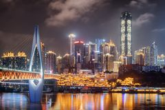 Night view of skyscrapers and the Qianximen Bridge in Chongqing stock photography