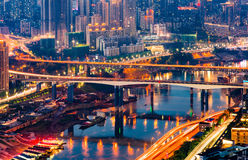 Chongqing City Night Light. Over jialing river with boat and skyscraper and colorful reflections Stock Photos