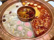 Chongqing hot pot close-up. Chongqing double flavor dish with spicy soup and meat balls Stock Photo