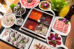 Chongqing hot pot. A table of dishes Royalty Free Stock Image