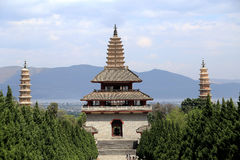 Chongshen temple and Three Pagodas in Dali. Yunnan province. China. Three Pagodas in Dali. Yunnan province. China. Photo taken on: April ,2015 stock photo