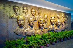CHONGYUANG TEMPLE, CHINA - 29 JANUARY, 2017: Memorial wall showing the faces of communist party founding members Stock Photos