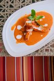 Choo Chee - Thai Spicy red curry thick sauce with grilled salmon. Choo Chee - grilled salmon with Thai Spicy red curry thick sauce and coconut milk, kaffir lime royalty free stock photography