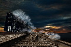 Choo, choo train. Old type of the train engine approaching royalty free stock photo