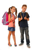 Choolboy and schoolgirl with schoolbags isolated over white back Royalty Free Stock Photography