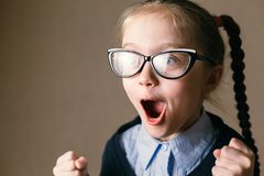 Choolgirl in a shock. Educational concept. royalty free stock photography