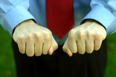 Choose. Business man with both hands in a fist stock photos