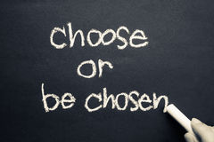 Choose or be chosen. Concept, handwritten with chalk royalty free stock photos