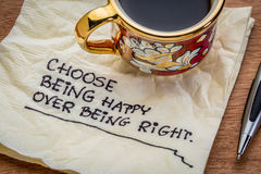 Choose being happy reminder on napkin Stock Images