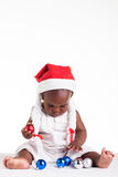 Choose colours. A tiny African baby girl are ready for her first Christmas to arrive Stock Images