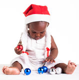 Choose colours. A tiny African baby girl are ready for her first Christmas to arrive Royalty Free Stock Photography
