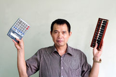Choose of Electronic Calculator or traditional aba Royalty Free Stock Photo