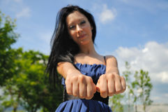 Choose a fist. Brunette woman with fists. choose a fist game royalty free stock photos