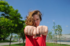 Choose a fist. Girl with fists. choose a fist game royalty free stock photography