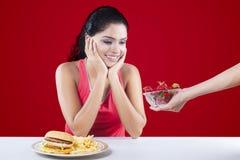 Choose Between Hamburger Versus Strawberry Stock Photo